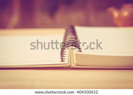 open book with blank pages on wooden background - vintage effect style picture - stock photo