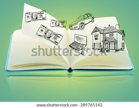Open book with drawings on green background - stock photo