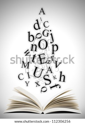 Open book with falling letters over grey background - stock photo