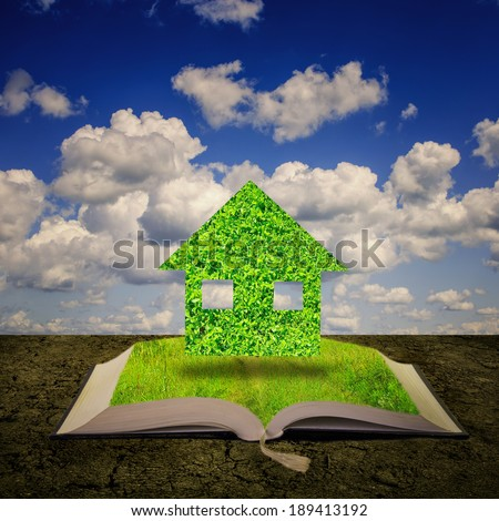 Open book with green house coming out of its pages, ecology concept.  - stock photo