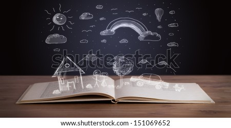 Open book with hand drawn landscape on wooden deck - stock photo