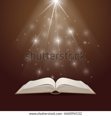 Open book with mystic bright light. Education and reading concept.