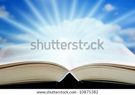 open book with mystical rays of light coming out of it
