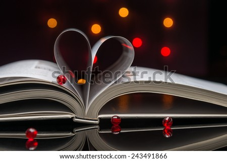Open book with pages shaped as a heart. - stock photo