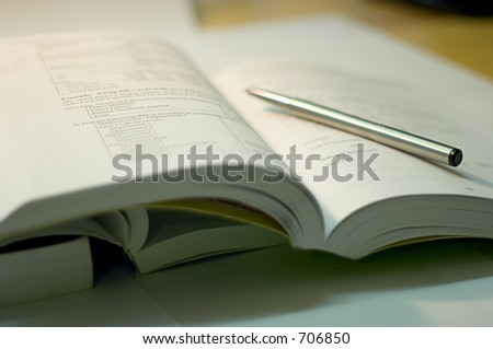 open book with steel pen, soft focus - stock photo