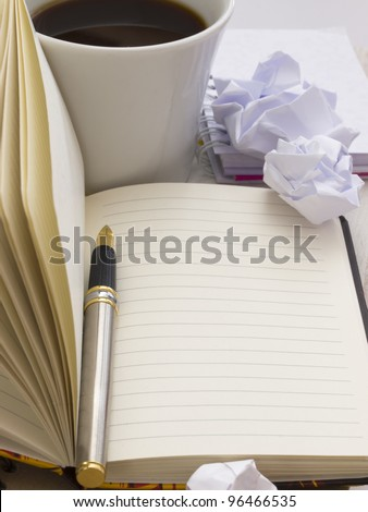 open booknote with pencil and coffee - stock photo