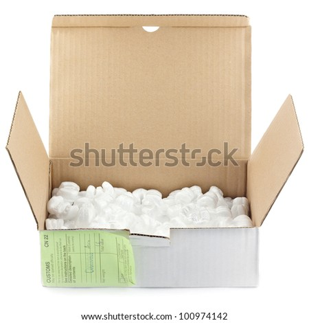 Open box with packing 'peanuts' isolated on white - stock photo