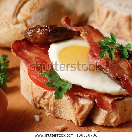 open breakfast sandwich with egg bacon mushroom fresh organic bread - stock photo