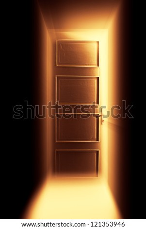 Open bright door with orange light. - stock photo