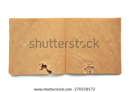 open brown crumpled and torn sketchbook made of recycled paper on white background - stock photo