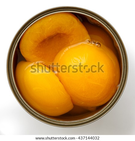 Open can of peach halves in syrup from above. Isolated on white.