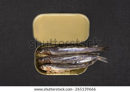 Open can with sardines isolated on black textured background, top view. Culinary seafood eating.  - stock photo