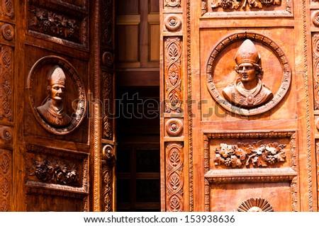 open church door with delicate carvings - stock photo