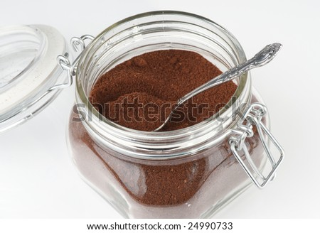 Open coffee jar wuth ground coffee - stock photo
