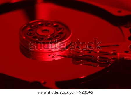 open computer hard disk in red light