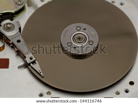 Open computer hard drive on white background (HDD, Winchester)