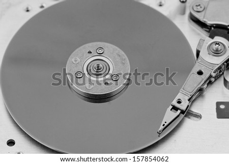 Open computer hard drive on white background in bw color (HDD, Winchester)