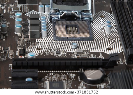 Open connector for the processor in the computer motherboard close-up - stock photo