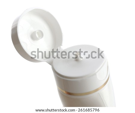 Open cosmetic bottle isolated on white - stock photo