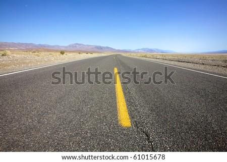 Open desolate highway - stock photo