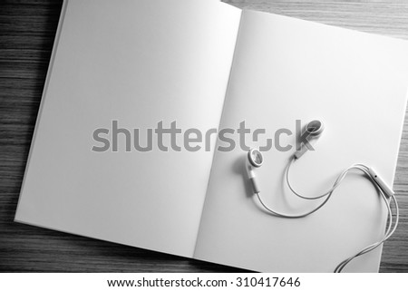 open diary and headphone on a wooden table. Study and journal concept - vintage effect style picture. - stock photo