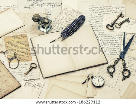 open diary book, antique accessories, old letters, inkwell and vintage feather ink pen. retro style toned picture - stock photo