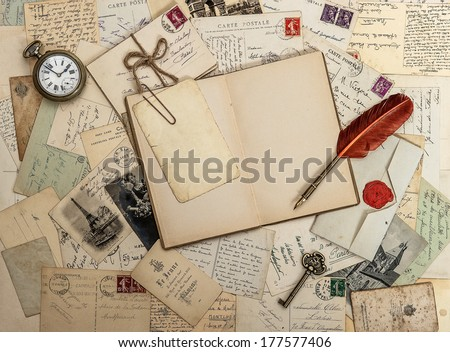 open diary book, old accessories and postcards. sentimental vintage style background - stock photo