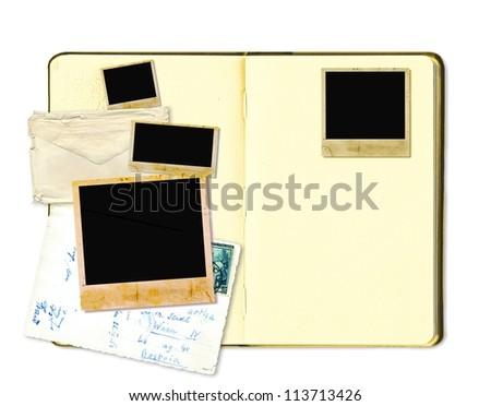 Open diary book or photo album with vintage instant photos - stock photo