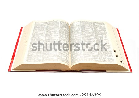 Open dictionary on white background