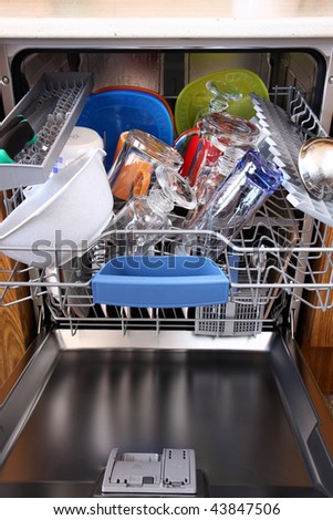 open dishwasher with clean dishes in kitchen - stock photo