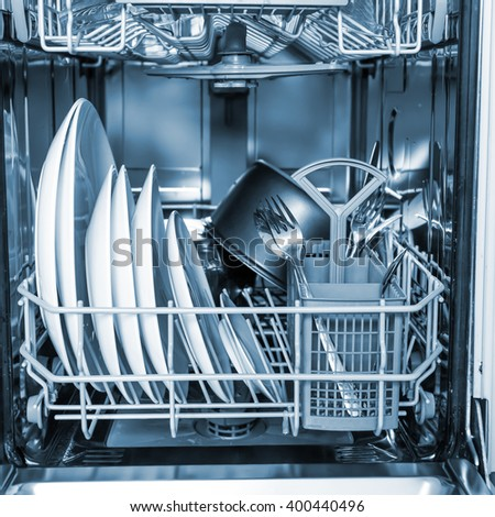 Open dishwasher with clean glass and dishes, selective focus - stock photo
