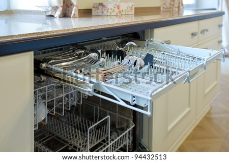 open dishwashing machine in the kitchen - stock photo
