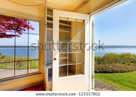 Open door from the living room to the back yard with water view.
