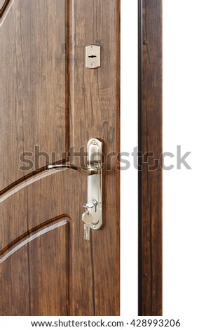 Open door handle. Door lock with keys. Brown wooden door closeup isolated. Modern interior design, door handle. New house concept. Real estate. Vertical image - stock photo