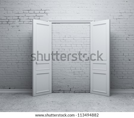 open door in a brick wall - stock photo