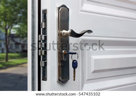 open door of a family home closeup of the lock with your keys