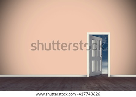 Open door on green wall against blue sky - stock photo