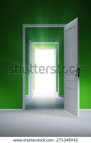 Open door with rays of light in the corridor with green walls - stock photo