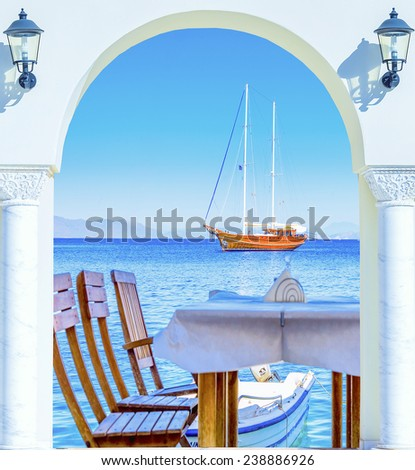 open door wooden sailing ship is at anchor view from the shore - stock photo