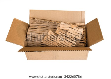 Open empty cardboard shipping box with eco-friendly packing material on isolated white background - stock photo