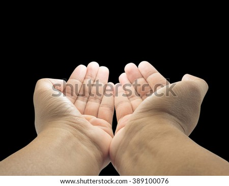 open empty pray hands isolated on the black background - stock photo