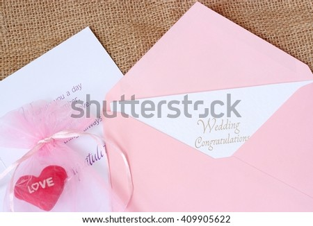 Open envelope with Wedding Congratulations card. typography lettering decorative text card design - stock photo