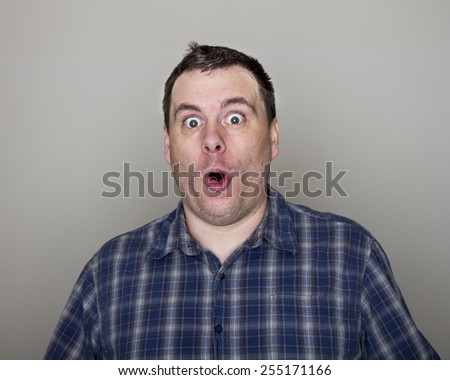 open eyes, open mouth, big face he is looking at something - stock photo