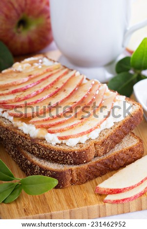 Open faced sandwich with ricotta, apple and caramel for breakfast - stock photo