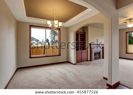 Open floor plan interior with carpet floor and fireplace