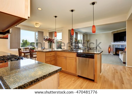 Open floor plan. Kitchen room interior with granite counter top and island. Northwest, USA