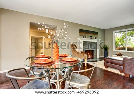 Open floor plan. Modern dining area with glass table. Hardwood floor. Northwest, USA