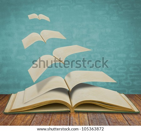 Open flying old books - stock photo