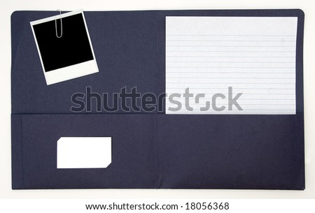 Open folder with old instant photo, note paper, and blank business card