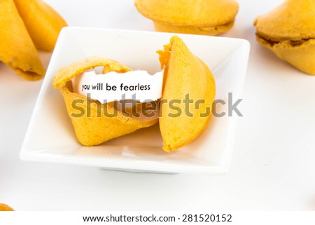 open fortune cookie with strip of white paper - YOU WILL BE FEARLESS
